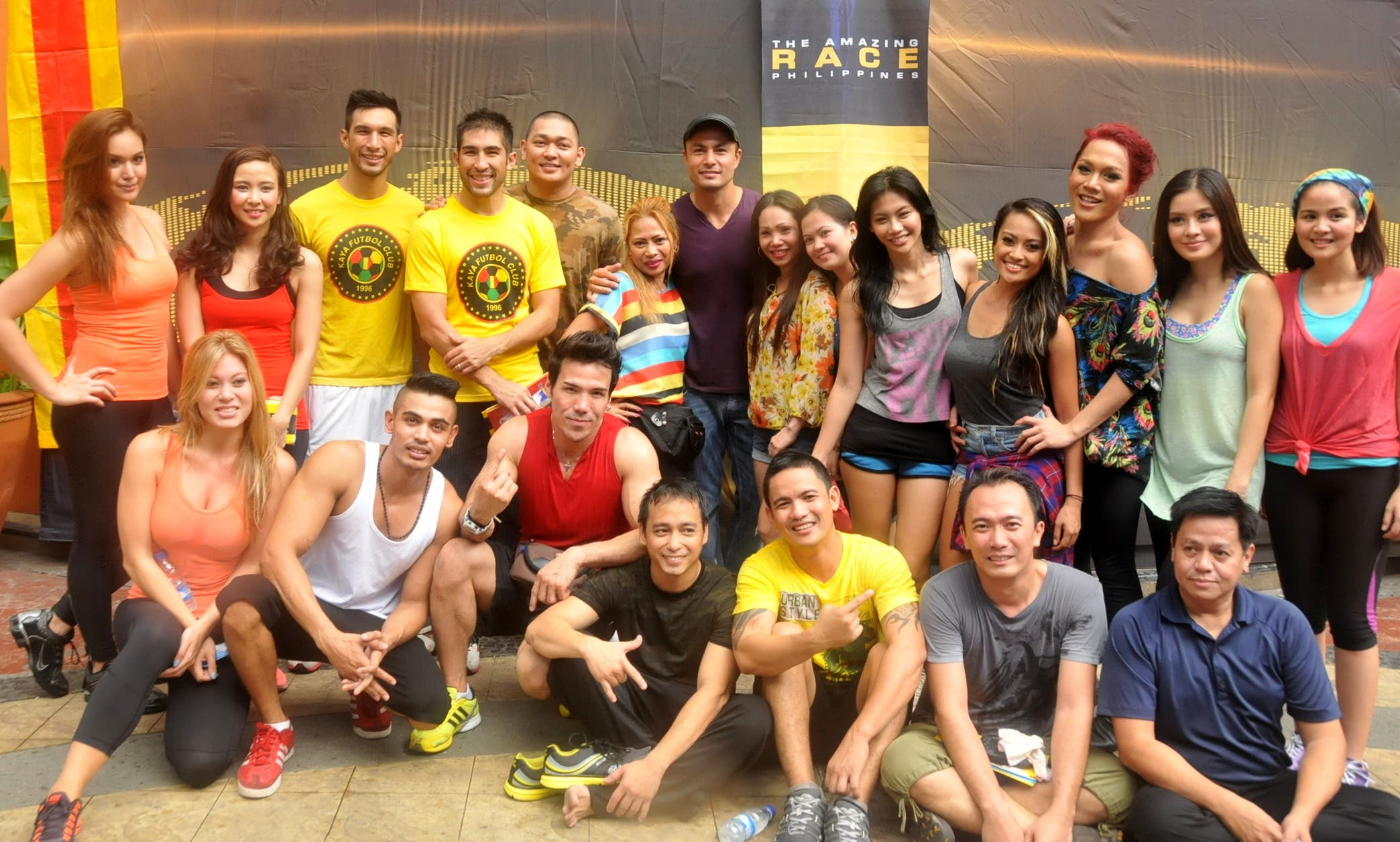 Host Derek Ramsay (center) with the 11 teams racing for the P2 million grand prize of The Amazing Race Philippines