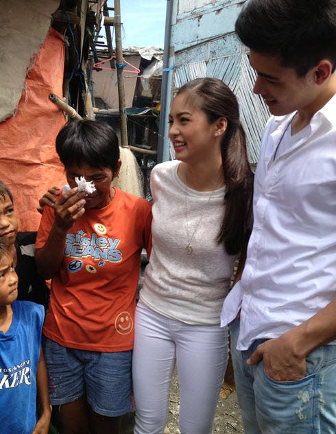 Kim and Xian visit Kim's foster family when she joined the reality