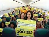 Cebu Pacific VP for Human Resources Rhea Villanueva, crew and passengers with Yelen Bontuyan, the airline's 100 millionth passenger