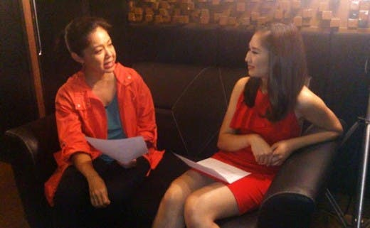 Songwriter and composer Trina Belamide shares a light moment with Sarah Geronimo during the recording of this year's Jollibee Family Values Awards theme song.